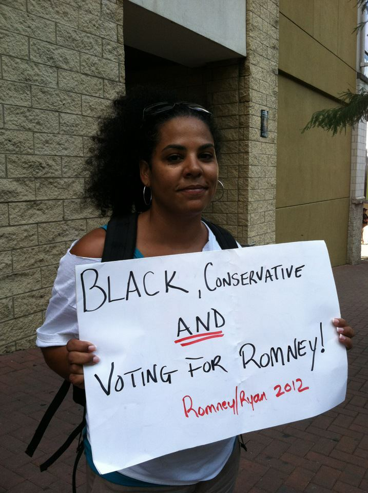 Conservative Blogger Kira Davis scares liberals like Chris Matthews with her sign.
