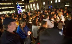 Strangers and friends gather to pray for Lake City Officer Shawn Schneider. -photo by Star Tribune