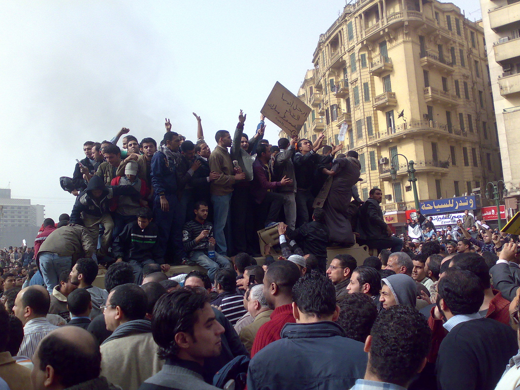 Demonstrators mob a tank in Tahrir Square, Cairo Egypt