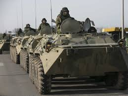 Russian BTR 90s drive in convoy in the occupation of Crimea in Ukraine. The Russians, like the US, are far too dependent on their armored vehicles.