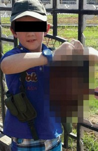 Need a reason to keep an AR-15? Here's one: a muslim child holding the head of a slain Iraqi man.