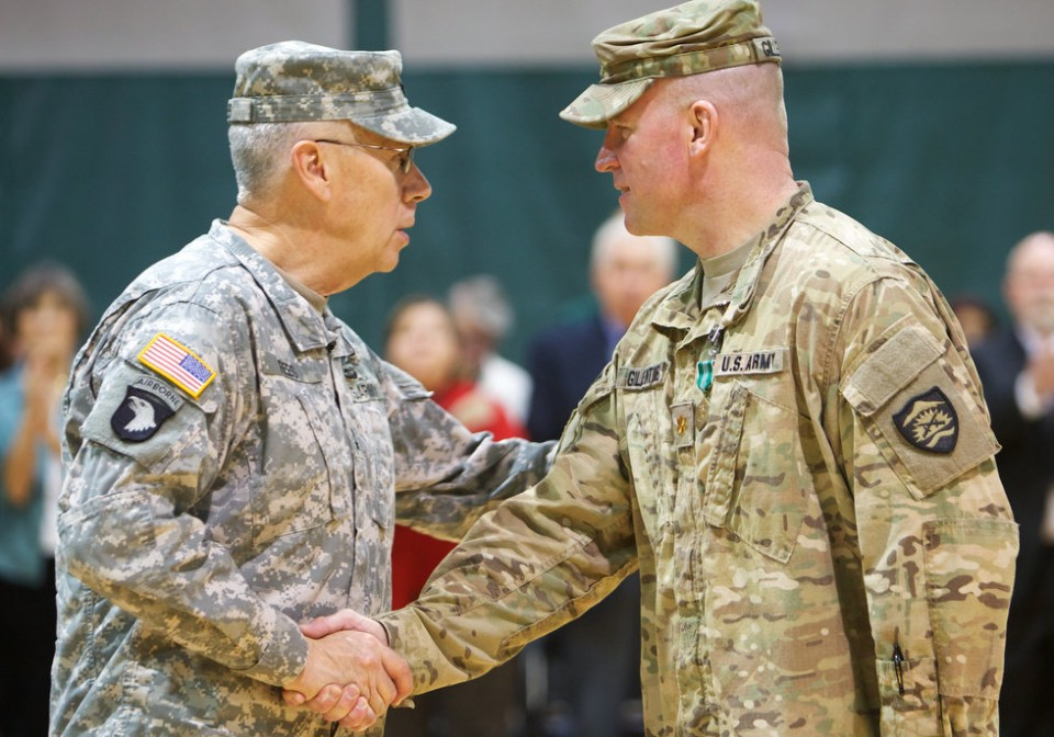 Commander of the 1186 MP company is congratulated on a successful mission by his Adjutant General. Military Police companies like the 1186 may be the right fit to deal with a lawless Oregon militia. -photo from The Oregonian.